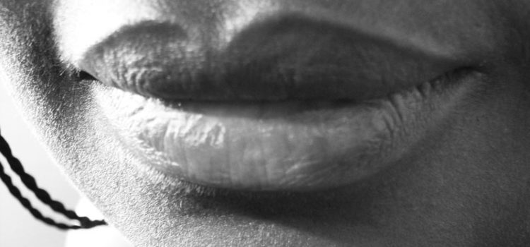 A close up of lips with a slight smile