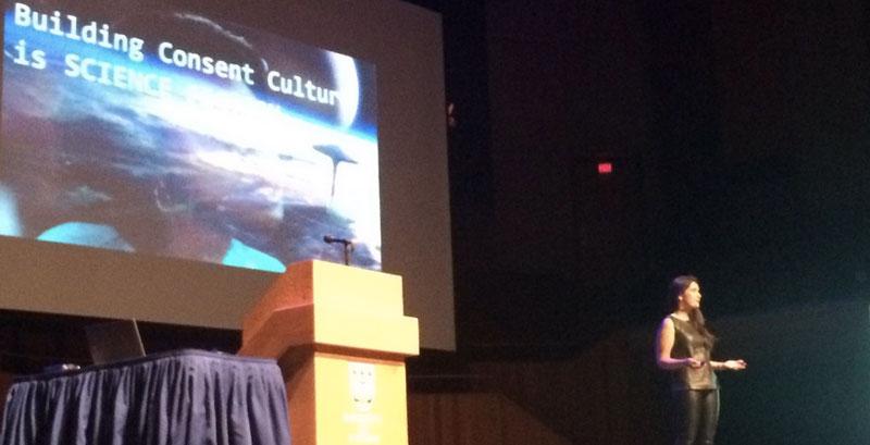 Farrah Kahn speaks on stage at UVic
