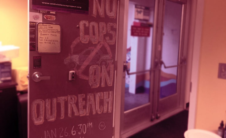 "Chalk art on the AVP door: ""no cops on outreach"""