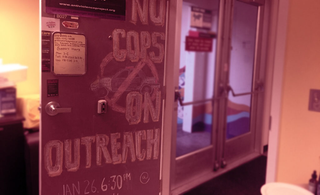 "Chalk art on the AVP door: ""no cops on outreach"""