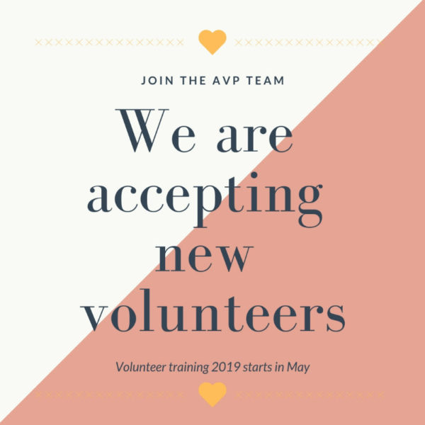Text: Join the AVP Team, we are accepting new volunteers, volunteer training 2019 starts in May. Background image is off white and pink with two yellow heart details